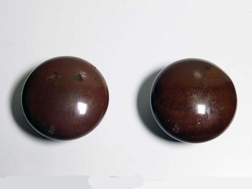 Early redware knobs with brown mineral glaze
