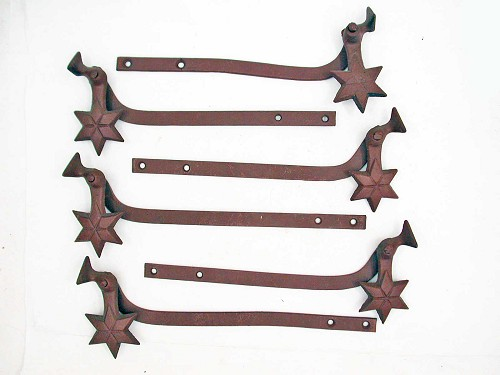 Victorian cast iron star shutter dogs